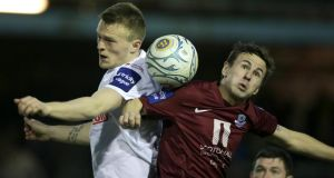 Drogheda's David Cassidy and Sligo's David Cawley clash in the first leg of the  Setanta Sports Cup semi-final.