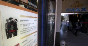 A woman leaves a Beijing cinema advertising Django Unchained before it was banned. Photograph: AP