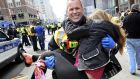 Boston firefighter James Plourde carries an injured girl away from the scene after  the Boston Marathon bombing. Photograph: Ken McGagh/AP Photo/MetroWest Daily News