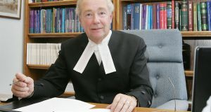 President of the High Court the Hon Mr Justice Nicholas Kearns.