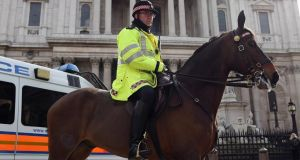 A mounted police officer stands outside St Paul's Cathedral ahead of the funeral of former British prime minister  Margaret Thatcher. Photograph:  Dan Kitwood/Getty Images