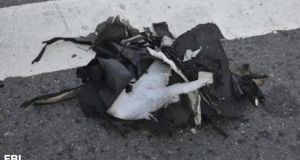 An FBI photograph  shows the remains of a black backpack they saycontained one of the bombs that exploded during the Boston Marathon.
