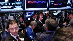 Traders gather for the initial public offering of Taylor Morrison on the floor at the New York Stock Exchange. Photograph: Brendan McDermid/Reuters