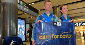 Orna Dilworth and Alan Dignam, from Knocklyon, who took part in the Boston Marathon, pictured on their arrival back at Dublin airport today.  Photograph: Eric Luke/The Irish Times