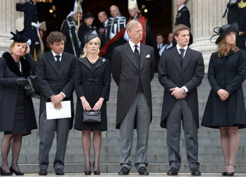 Carol Thatcher, Marco Grass, Sarah Thatcher, Mark Thatcher, Michael Thatcher and Amanda Thatcher look on from the steps of St Paul's Cathedral as the coffin is placed in the hearse after the funeral. Photograph: Jeff J Mitchell/Getty Images