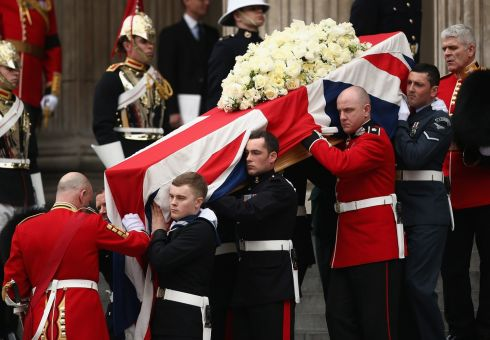 Members of the Armed Services carry the coffin after the service. Photograph: Dan Kitwood/Getty Images