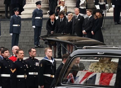 Carol Thatcher, Marco Grass, Sarah Thatcher, Mark Thatcher, Michael Thatcher and Amanda Thatcher look on from the steps of St Paul's Cathedral as the coffin is placed in the hearse after the funeral. Photograph: Dan Kitwood/Getty Images