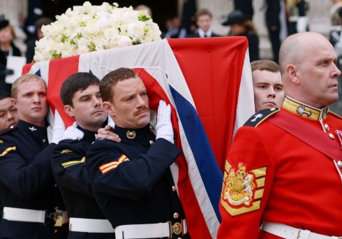 Members of the Armed Services carry the coffin after the funeral. Photograph: Jeff J Mitchell/Getty Images