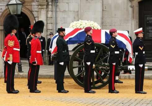 The coffin is transferred to the gun carriage drawn by the King s Troop Royal Horse Artillery at the Church of St Clement Danes. Photograph: Ian Walton/Getty Images