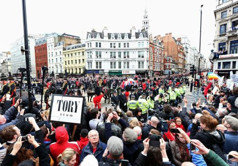 A protest sign as the coffin is carried on a horse drawn gun carriage at Ludgate Hill . Photograph: Clive Rose/Getty Images