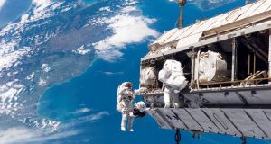 Astronauts working on the International Space Station. The Russian space agency has being taking space tourists there for the past decade. Photograph: Nasa