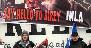Republicans in the bogside area of Derry, mark the death of Margaret Thatcher, carrying a poster referring to the INLA murder of Tory MP Airey Neave. Photograph: Paul Faith/PA Wire