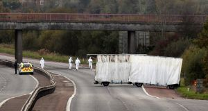 Forensic officers search the scene on the M1 motorway near the town of Lurgan in Northern Ireland where prison officer David Black was shot dead as he drove to work on November 1st last year. Photograph: Reuters