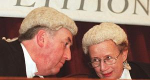 Mr Justice Peter Kelly confers with Mrs Justice Catherine McGuinness. Photograph: Frank Miller