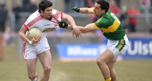 Kerry's Anthony Maher gets shirty with Tyrone's Sean Cavanagh.