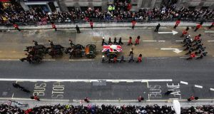 Margaret Thatcher's coffin is carried on a horsedrawn gun carriage through Fleet Street in London during the ceremonial funeral of the former British prime minister yesterday. Photograph:Peter Macdiarmid/Getty Images
