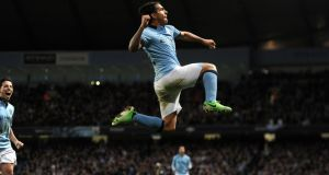 Manchester City's Carlos Tevez celebrates scoring the  winning   goal against Wigan   at the Etihad Stadium. Photograph: Martin Rickett/PA