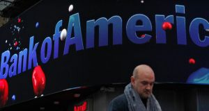 A man walks next to a Bank of America branch in New York. Photograph: Reuters/Eduardo Munoz