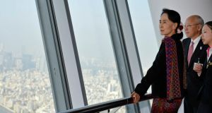 Burmese Nobel laureate and opposition leader Aung San Suu Kyi observes the view from the 350m high  observation deck at the Tokyo Skytree, the world's tallest broadcasting tower  in Tokyo today. Ms Suu Kyi is in Japan for a seven-day visit. Photograph: Franck Robichon/Reuters