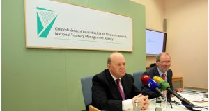 Minister for Finance Michael Noonan and NTMA chief executive John Corrigan during the NTMA annual report launch at Treasury Buildings, Dublin. Photograph: Brenda Fitzsimons/Irish Times