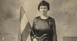 Flying the flag: Catherine Boyle of the US National Woman's Party with a suffrage tricolour around 1910. Photograph: Library of Congress