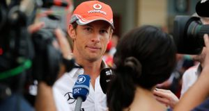 McLaren driver Jenson Button speaks to the media on Thursday ahead of Sunday's Bahrain Grand Prix at the Sakhir circuit in Manama. Photograph: Reuters/Darren Whiteside