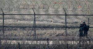 South Korean soldiers patrol along the military fences near the demilitarized zone separating North Korea from South Korea. Photograph: Lee Jae-Won/Reuters