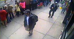 The FBI has released photographs of two suspects in the investigation into Monday's Boston Marathon bombings.