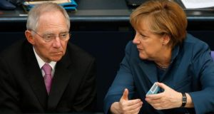 German Chancellor Angela Merkel talks to Finance Minister Wolfgang Schaueble. Photograph: Fabrizio Bensch/Reuters