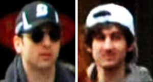 The Boston marathon suspects. Police in the city  are conducting a manhunt for the white-capped individual on the right. Photograph: FBI/Reuters
