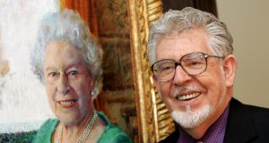 Rolf Harris officially unveils his oil portrait of Queen Elizabeth II at The Queen's Gallery in Buckingham Palace in December 2005. Photograph:  Chris Jackson/Getty Images