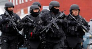 Swat teams enter a suburban neighborhood to search an apartment for the remaining suspect in the Boston Marathon bombings in Watertown, Massachusetts today. Photograph: Reuters