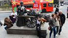 Tourists pose at the Molly Malone stature at Grafton Street, Dublin, yesterday. Photograph: Cyril Byrne
