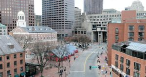 An empty street is seen near the historic Faneuil Hall (on left, with white cupola) and City Hall (back, centre) in Boston, Massachusetts, today, as the manhunt continues for Dzhokar Tsarnaev, the remaining suspect in the Boston Marathon bombings. Photograph: Neal Hamberg/Reuters