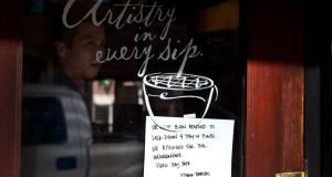 Starbucks windown in the financial district in Boston, Massachusetts. Photograph: Kayana Szymczak/Getty Images
