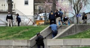 Law enforcement approach an area where Dzhokhar A Tsarnaev was hiding in Watertown, Massachusetts. Photograph: Darren McCollester/Getty Images