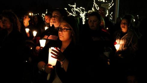 People hold candles as they listen to speakers during a candlelight vigil for the victims of the Boston Marathon bombings in Somerville, Massachusetts. Photograph: Jessica Rinaldi/Reuters