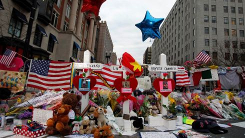 Three crosses for each of the three people killed in the Boston Marathon bombings at a makeshift memorial on Boylston Street. Photograph: Jessica Rinaldi/Reuters