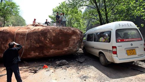 A giant rock blocks a road after the earthquake. Photograph: Reuters