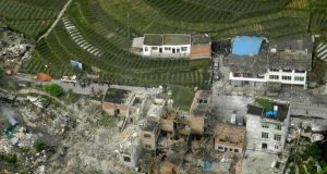 An aerial view shows houses damaged after a strong earthquake in Lushan county, Ya'an, Sichuan province. Photograph: China Daily/Reuters