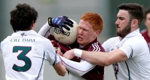 Kildare's David Hyland and Fergal Conway challenge Adrian Varley of Galway in Tullamore. Photograph: James Crombie/Inpho