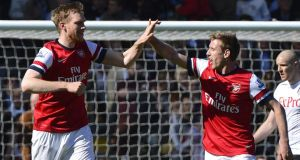 Arsenal's Per Mertesacker (left) celebrates with team mate Nacho Monreal after scoring against Fulham. Photograph: Toby Melville/Reuters
