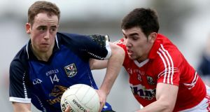 Cavan's Paul O'Connor is shadowed by Sean Kiely of Cork in Tullamore.  Photograph: James Crombie/Inpho