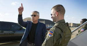 US secretary of defence Chuck Hagel waves before boarding an aircraft for a trip to the Middle East  at Joint Base Andrews, Maryland. Photograph:  Jim Watson/Getty Image