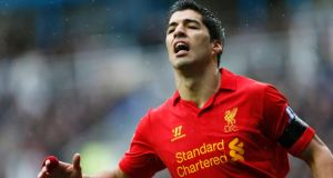 Liverpool's Luis Suarez says he wants to remain at Liverpool for now. Photograph: Eddie Keogh/Reuters