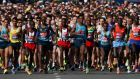 Competitors cross the start line after the moment's silence. Photograph: Eddie Keogh/Reuters