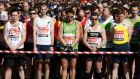 Runners observe a moment of silence before the start of the London Marathon in Greenwich, southeast London, this morning.  Photograph: Luke MacGregor/Reuters