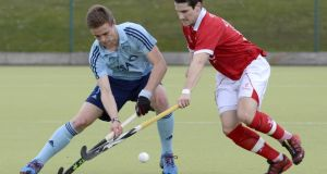 Lee Cole of Monkstown and Stuart Smyth of Cookstown tussle during their Men's Irish Hockey League game at Carryduff, Co Down. Photograph: Presseye/ Inpho