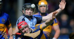 Tipperary's Michael Cahill is challenged by David O'Callaghan of Dublin. Photograph: Cathal Noonan/Inpho