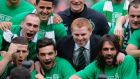 Celtic manager Neil Lennon (centre) celebrates  league victory with his team at Celtic Park.  Photograph: Russell Cheyne/Reuters
